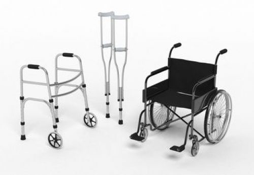 Black disability wheelchair, crutch and metallic walker isolated on white